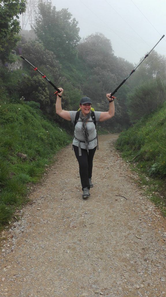 Woman walking with group Camino